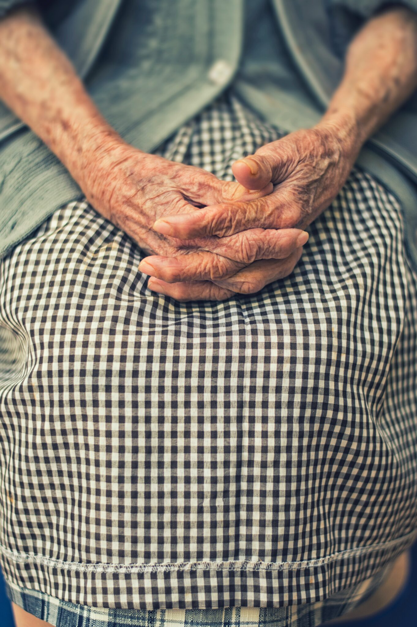 Elderly woman's hands folded together, for BGS blog Guardianship During COVID-19